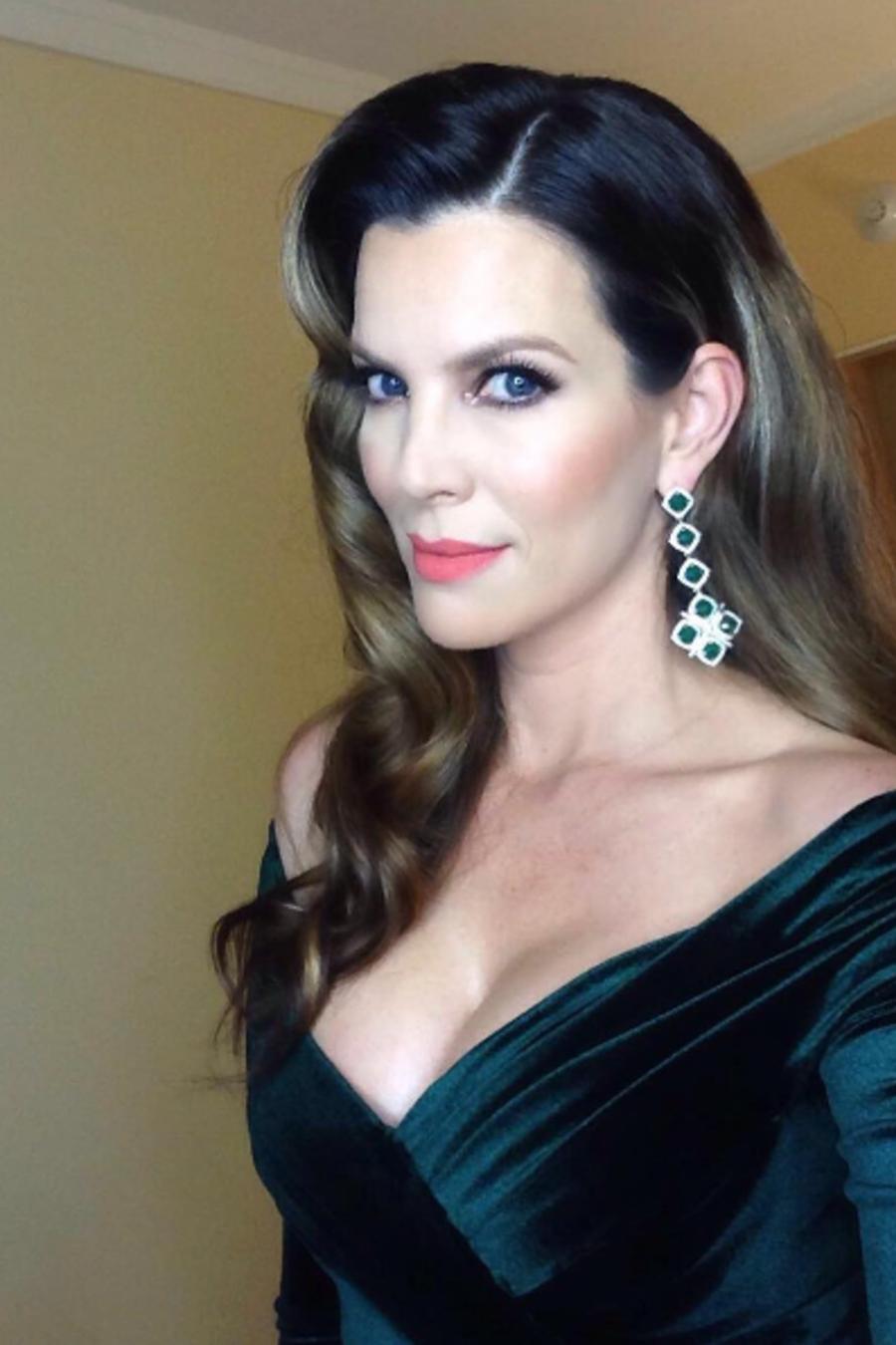 Maritza Rodríguez de vestido verde