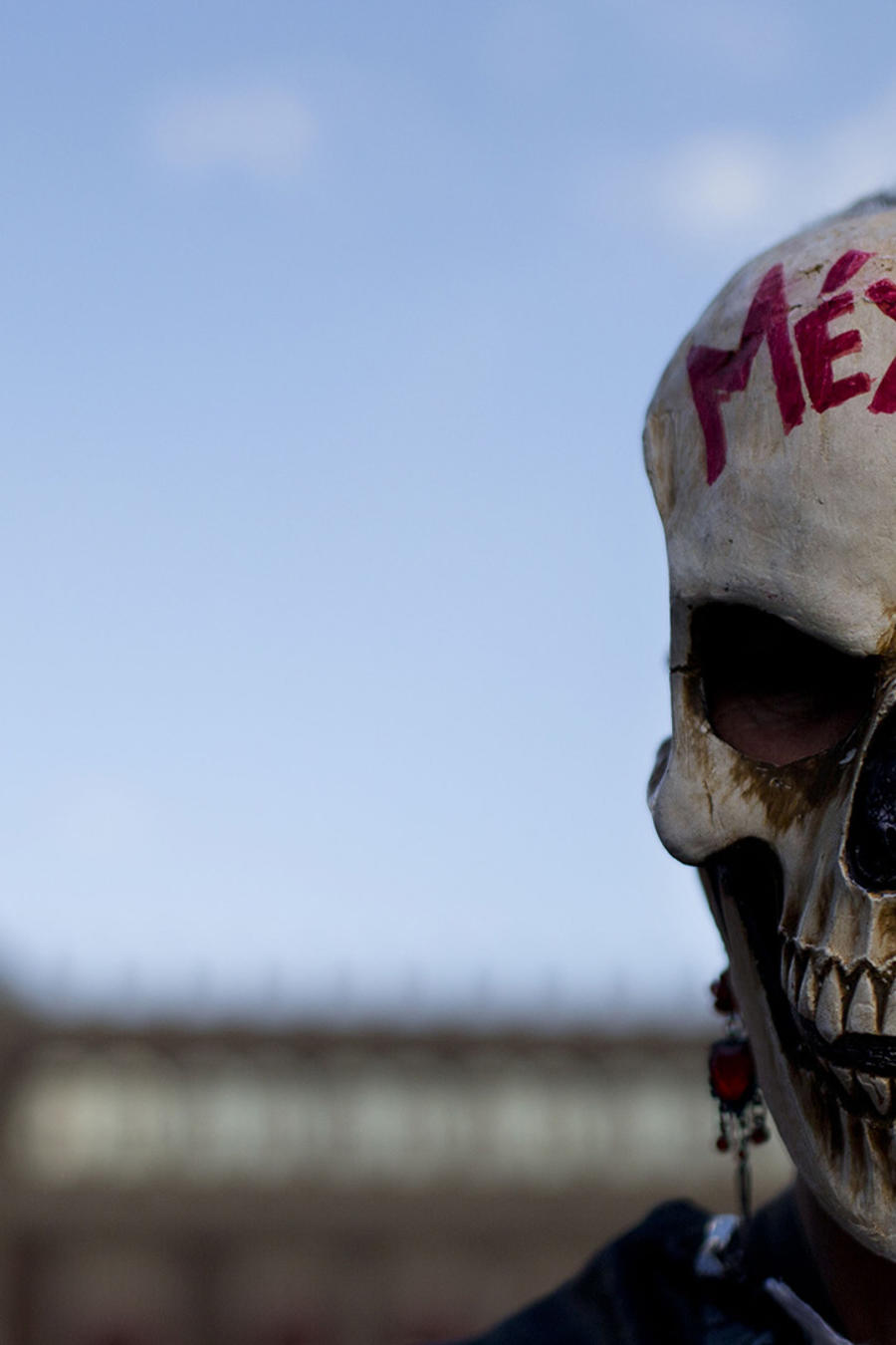 A woman wears a skull mask as she stands in front of the National Palace during a rally by relatives and supporters of 43 missing teacher's college students in the Zocalo, Mexico City's main square, Wednesday, Sept. 23, 2015. Days ahead of the one year an