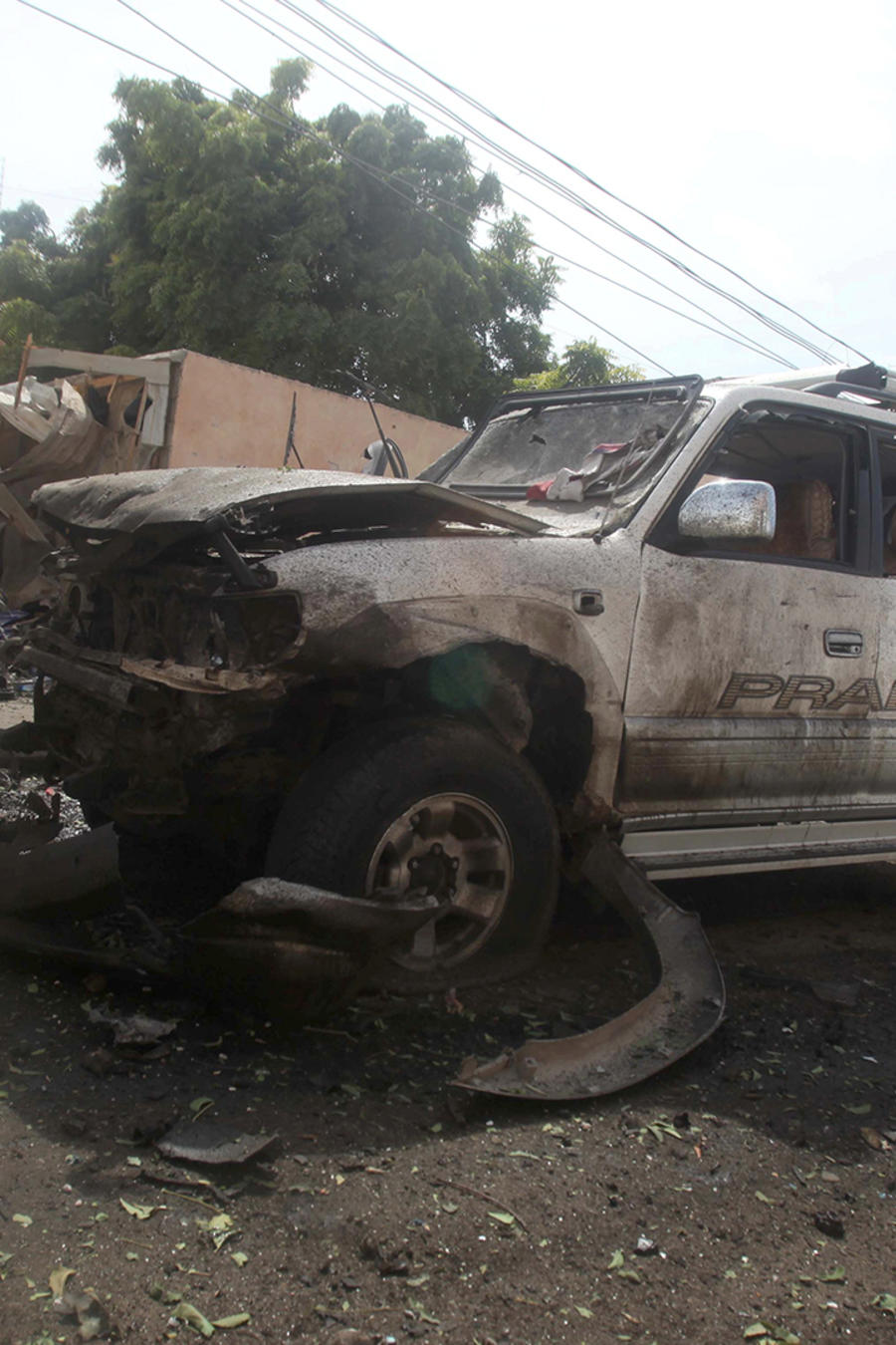 The wreckage of a car destroyed during a suicide bombing is seen near the African Union's main peacekeeping base in Mogadishu