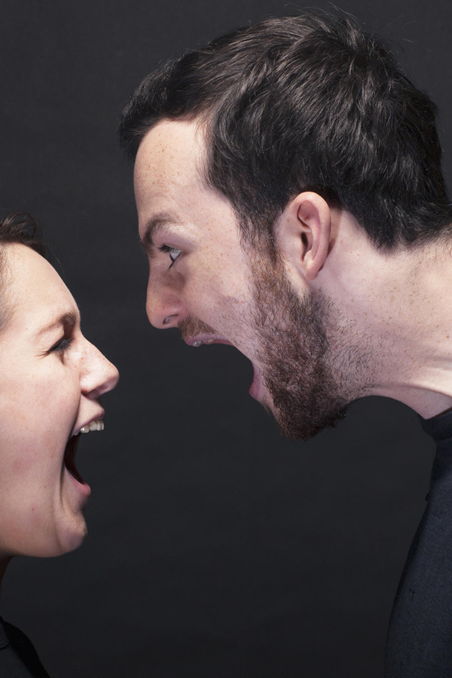 young man and woman shouting at each other