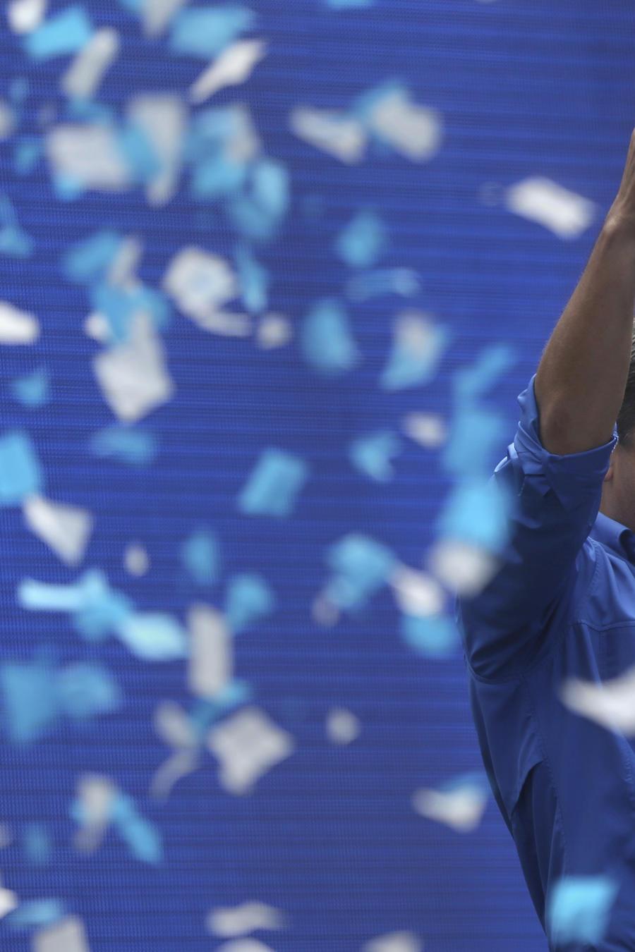 Elpresidente Juan Orlando Hernandez celebra su triunfo.