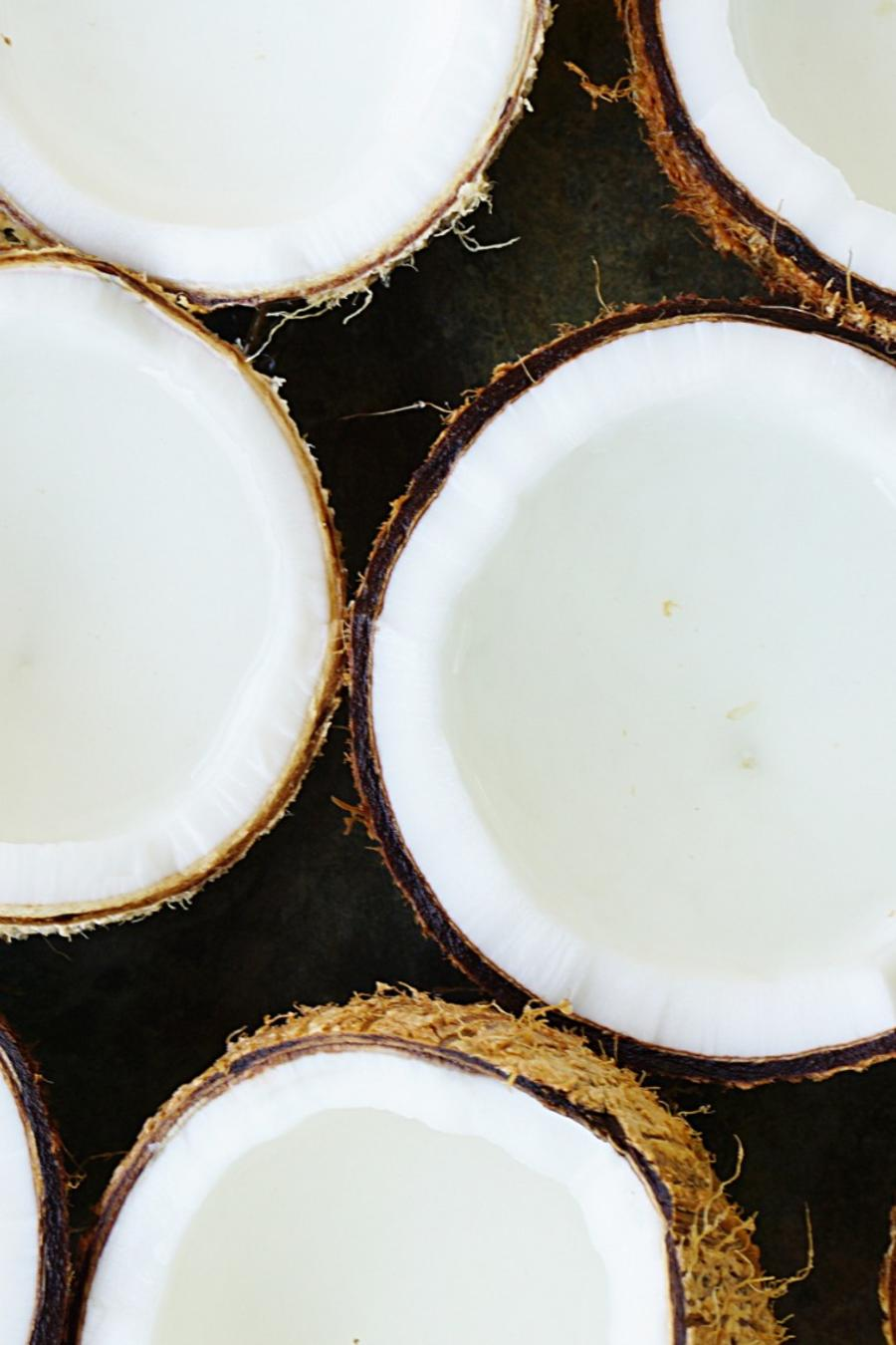 Coconut halves on a plate.