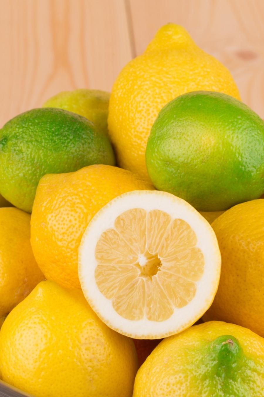 Lemons and limes in a colander.