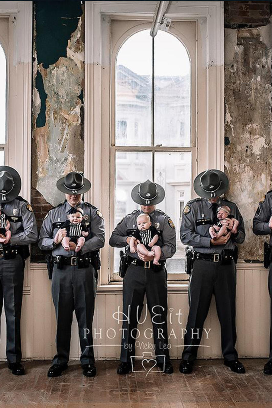 Kentucky Police Officers holding their newborns
