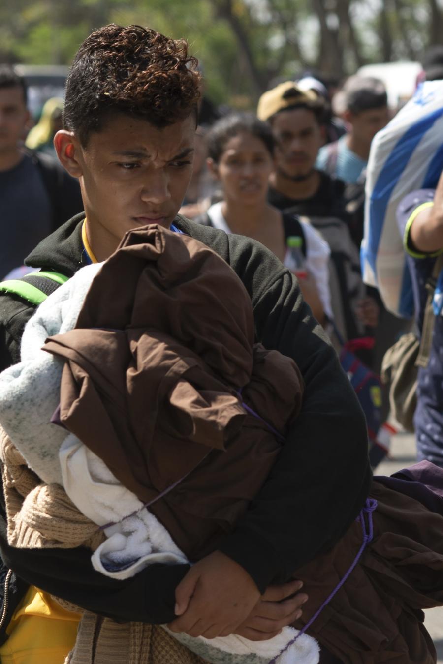Fotografía de archivo del 28 de marzo de 2019 de una caravana de 2.500 migrantes de Centroamérica y Cuba que caminaban por una carretera en Tapachula (Chiapas)