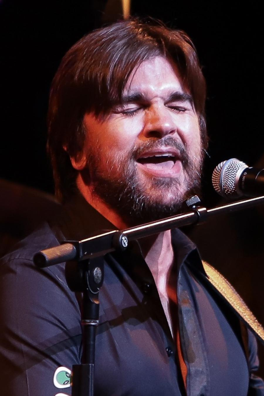 Juanes performing live at a show