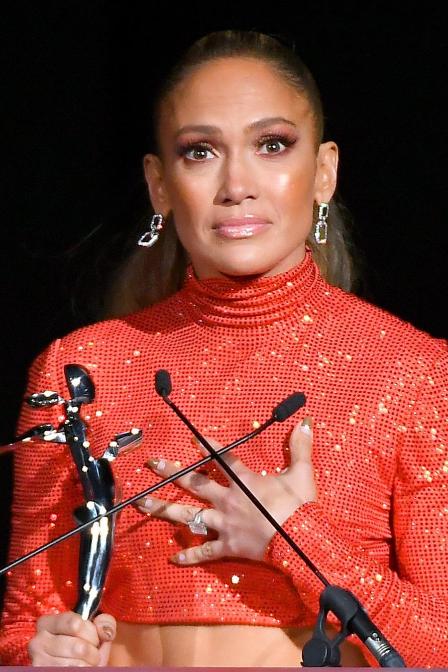 Jennifer Lopez gives speech in red-orange crop top