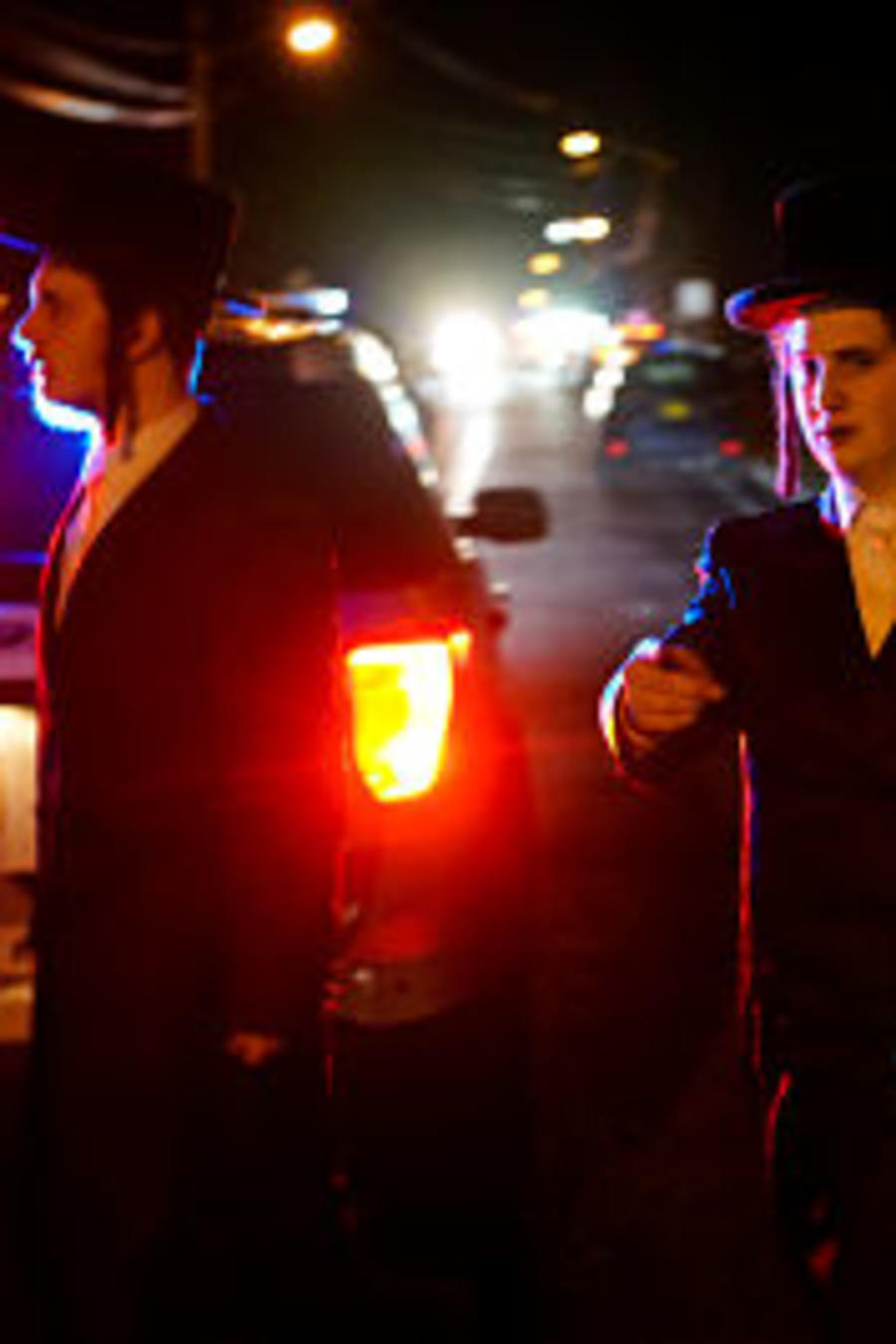 Jewish people try to reach the area where 5 people were stabbed at a Hasidic rabbi's home in Monsey, New York