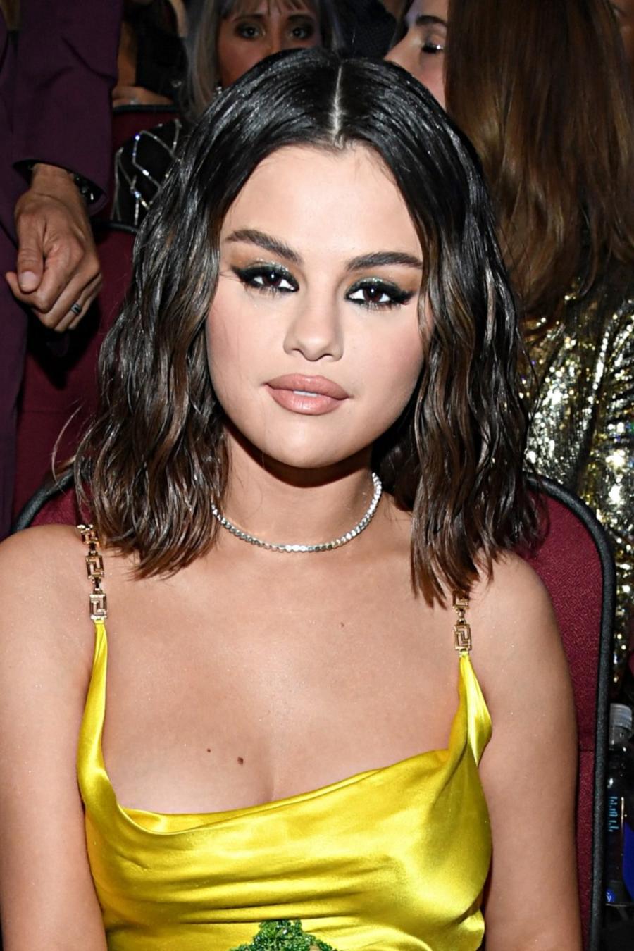 Selena Gomez wearing yellow slip dress