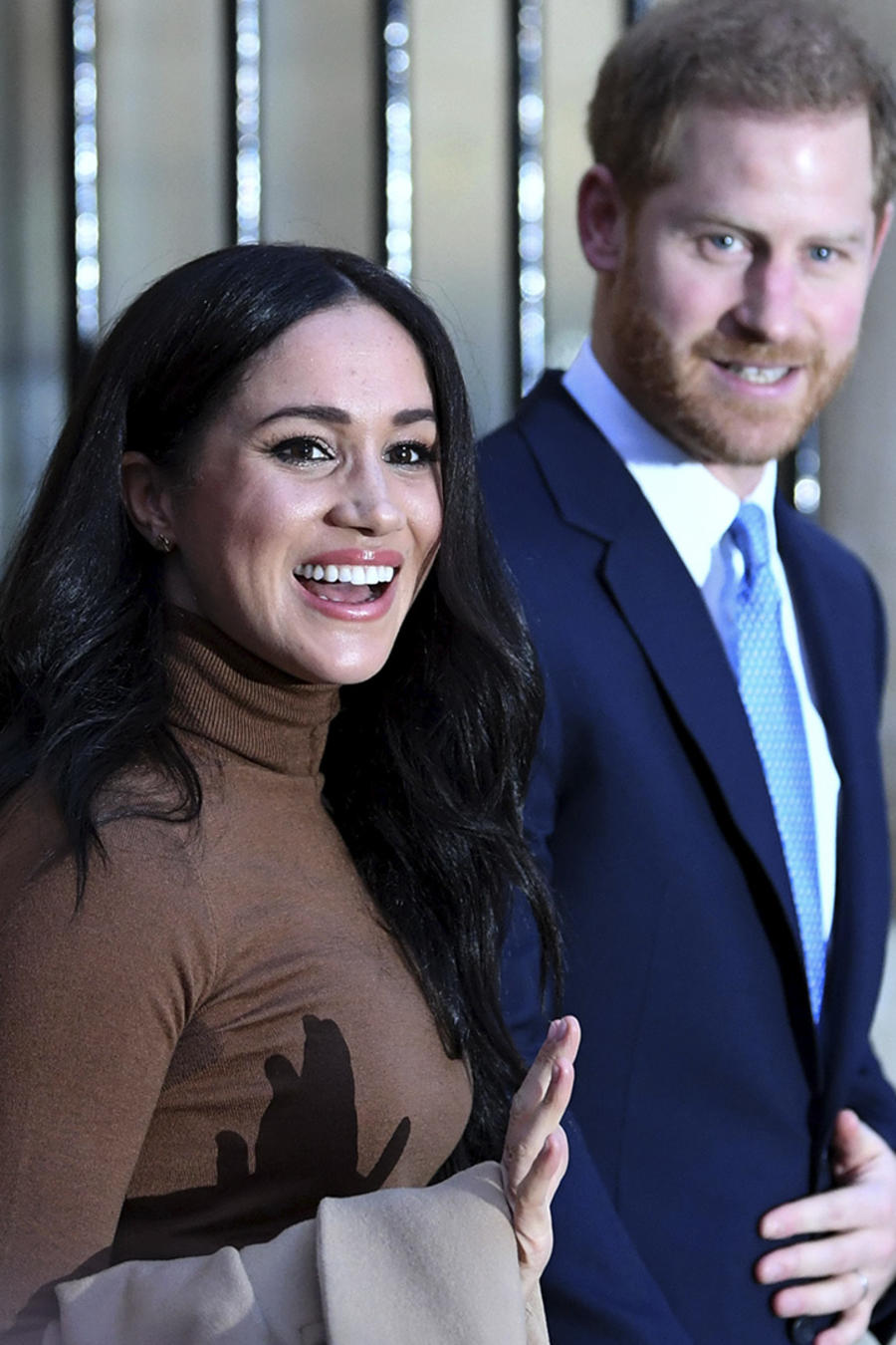 Meghan y Harry sonriendo