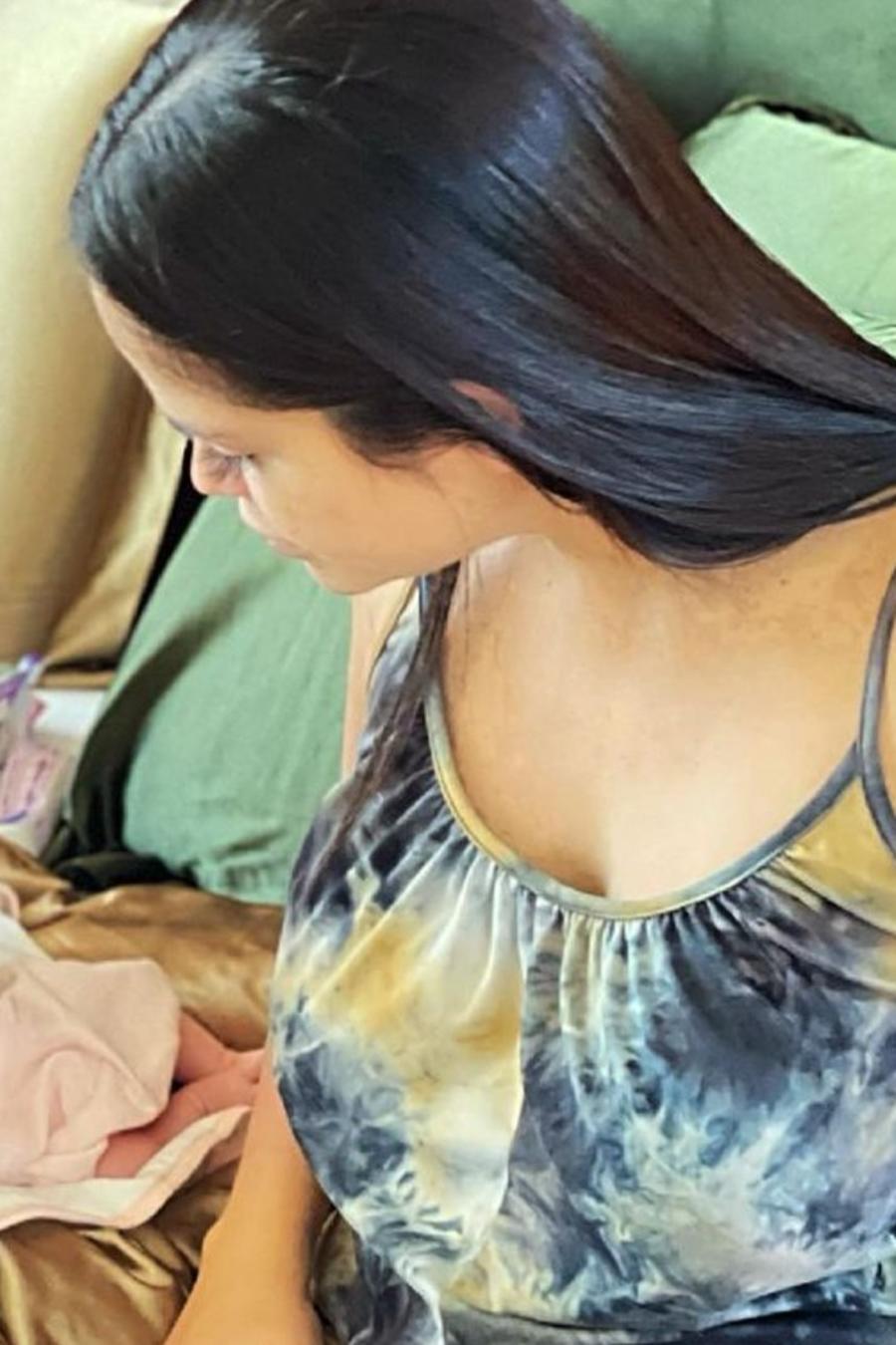 Natti Natasha y Raphy Pina, y su hija