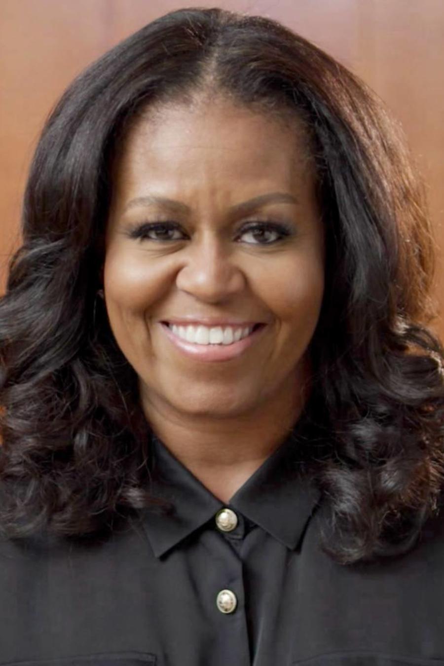 Michelle Obama con su padre Fraser Robinson