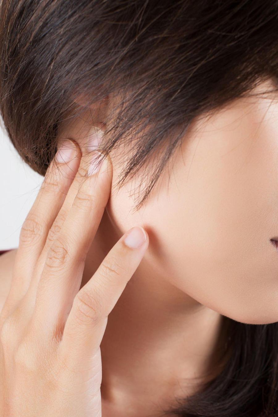 Mujer con dolor de cuello
