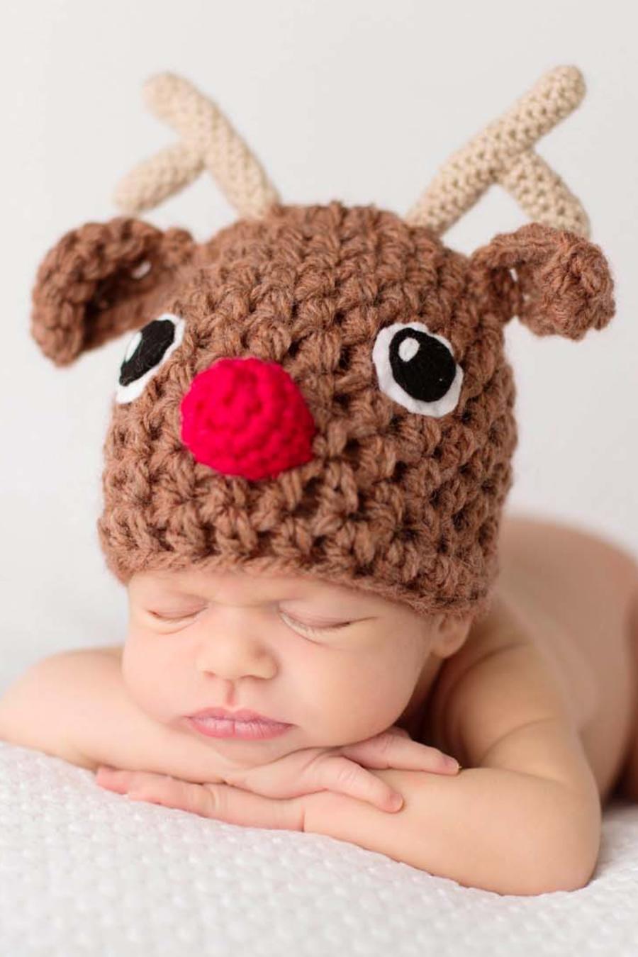 Bebés con sombreros de navidad