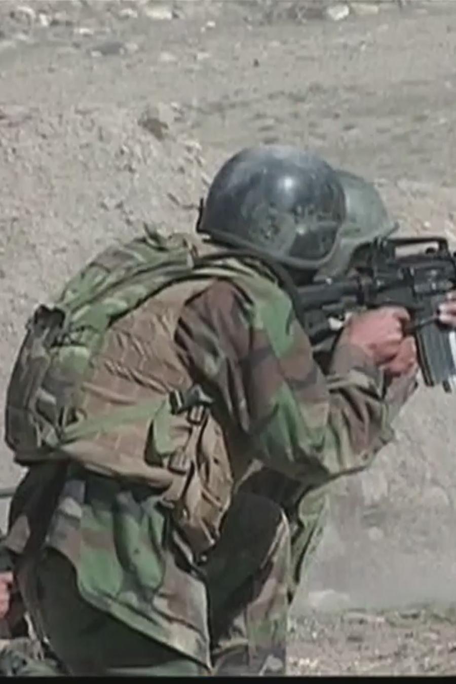 Foto de archivo de tropas en combate