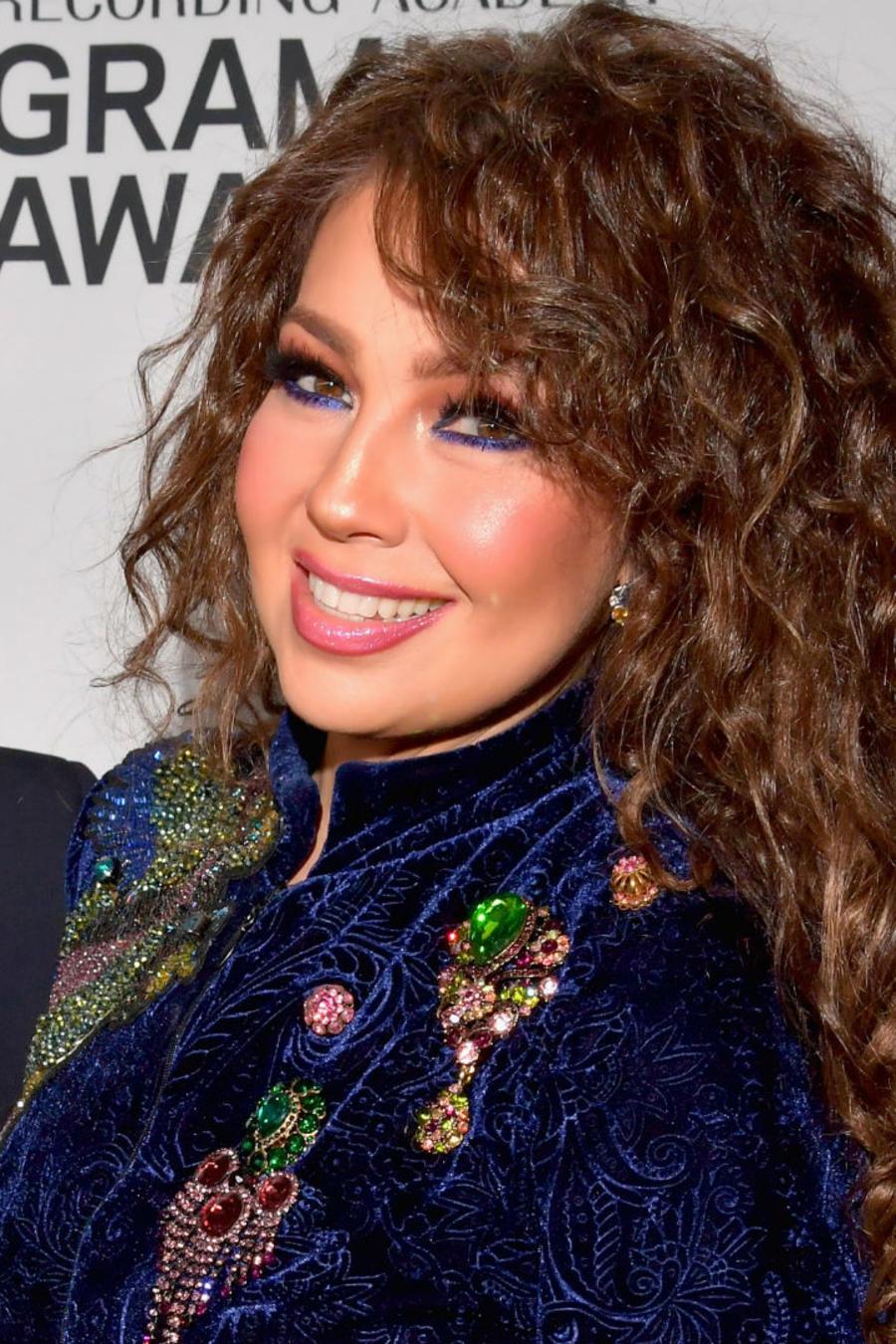Thalía con Tommy Mottola en los Grammy
