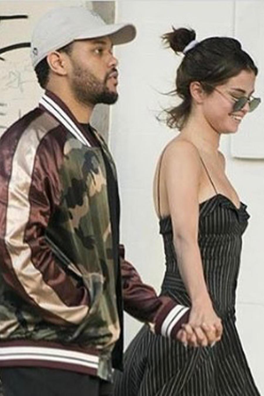 Selena Gomez y The Weeknd caminando en Argentina