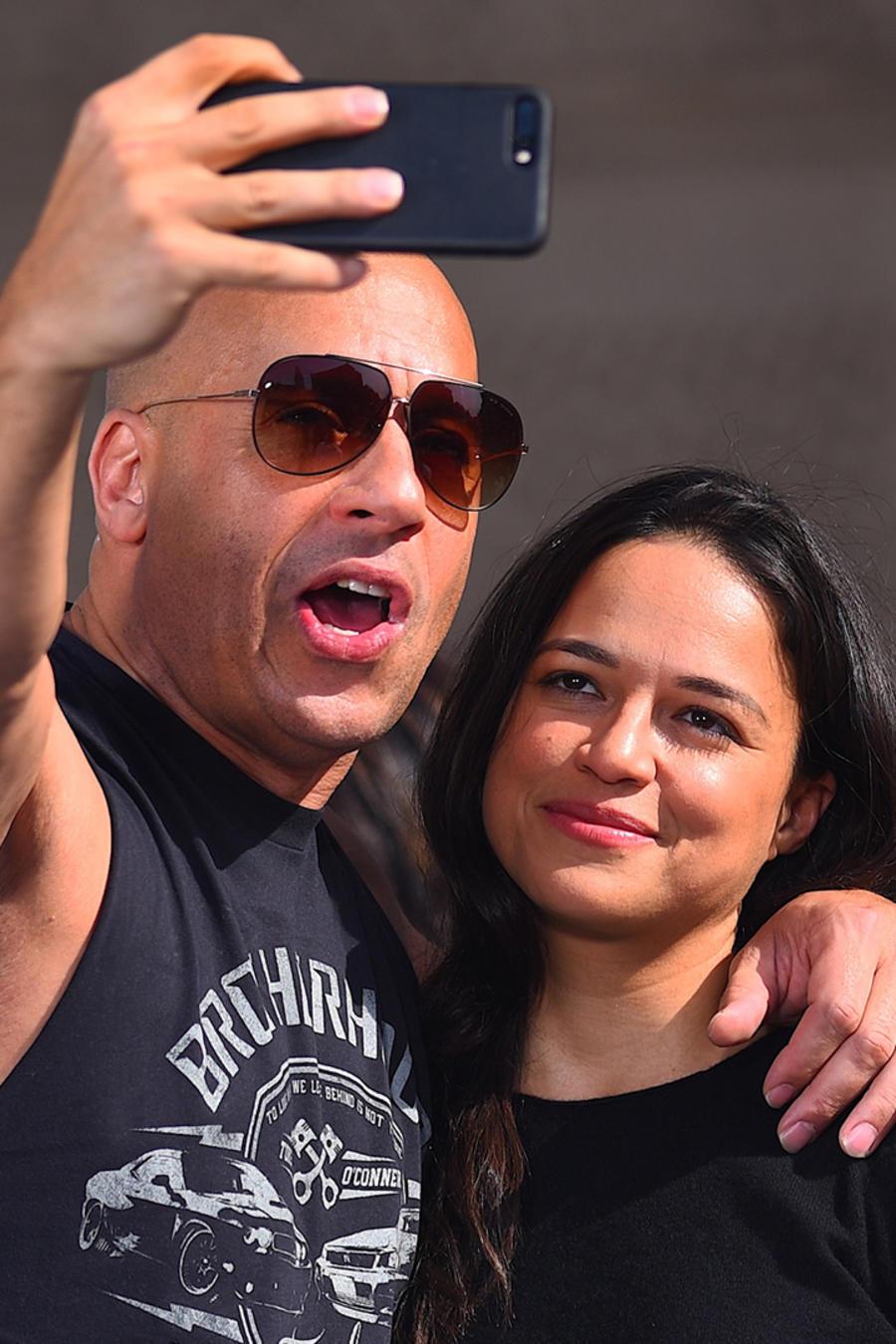 Michelle Rodriguez and Vin Diesel taking a selfie