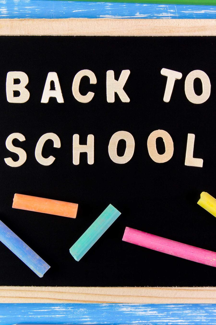 Back To School Text On Blackboard At Wooden Table