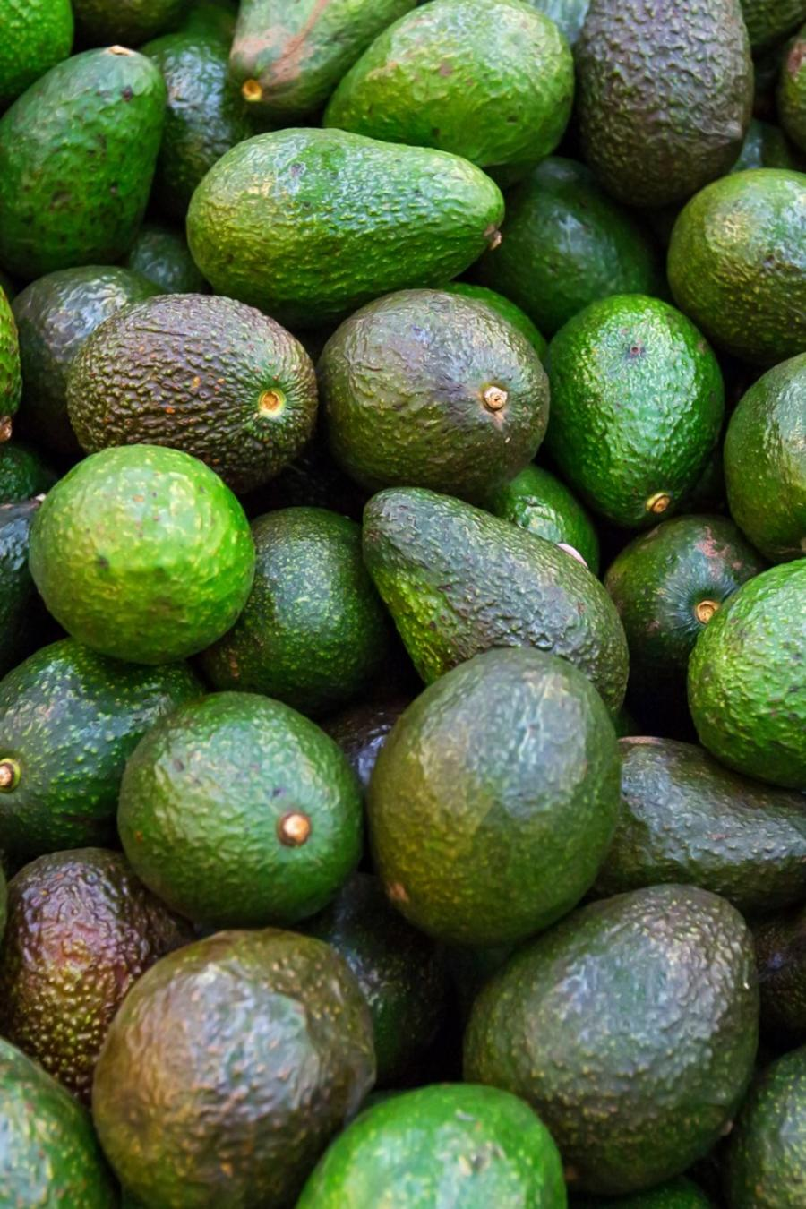 Whole avocados in the market.