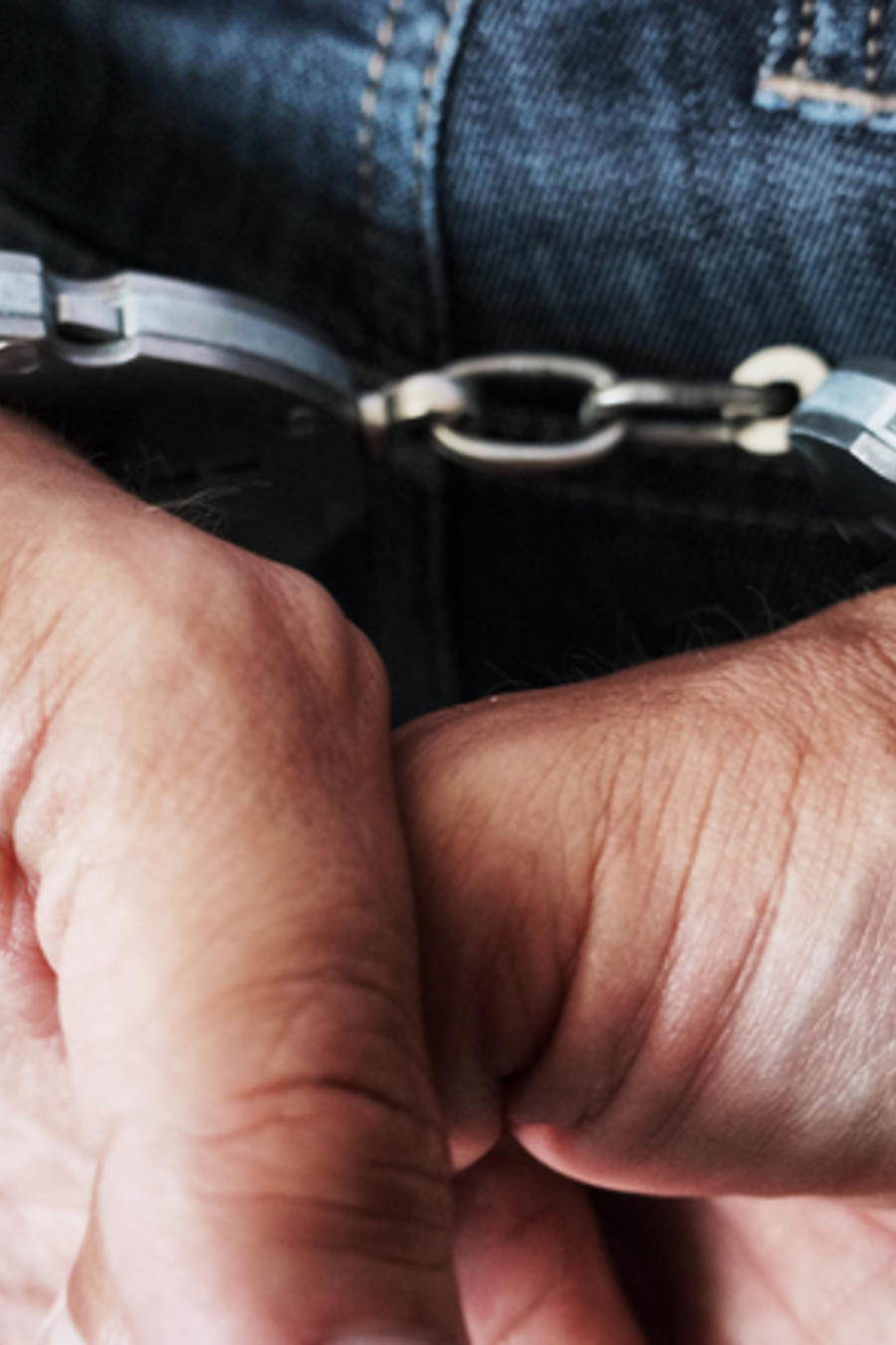 Cropped Hands Of Man With Handcuffs