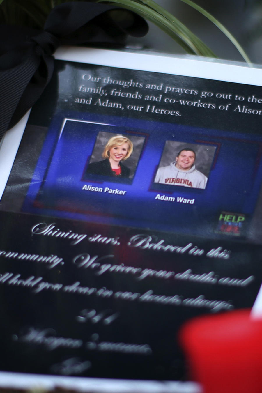 A picture of killed journalists Alison Parker and Adam Ward is seen next to candles at a memorial outside of the offices for WDBJ7 in Roanoke
