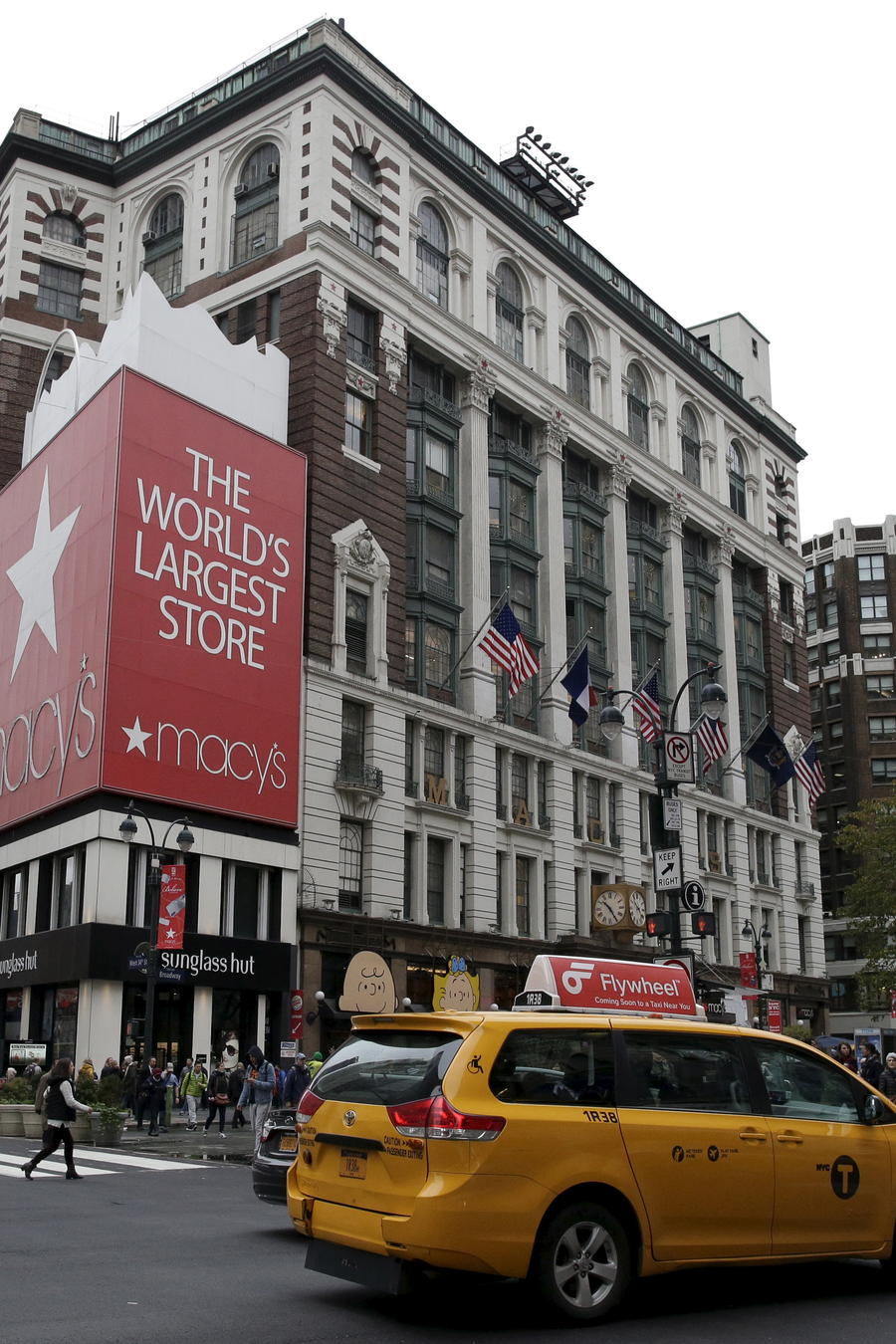 People pass by the Macy's flagship department store in midtown Manhattan in New York City