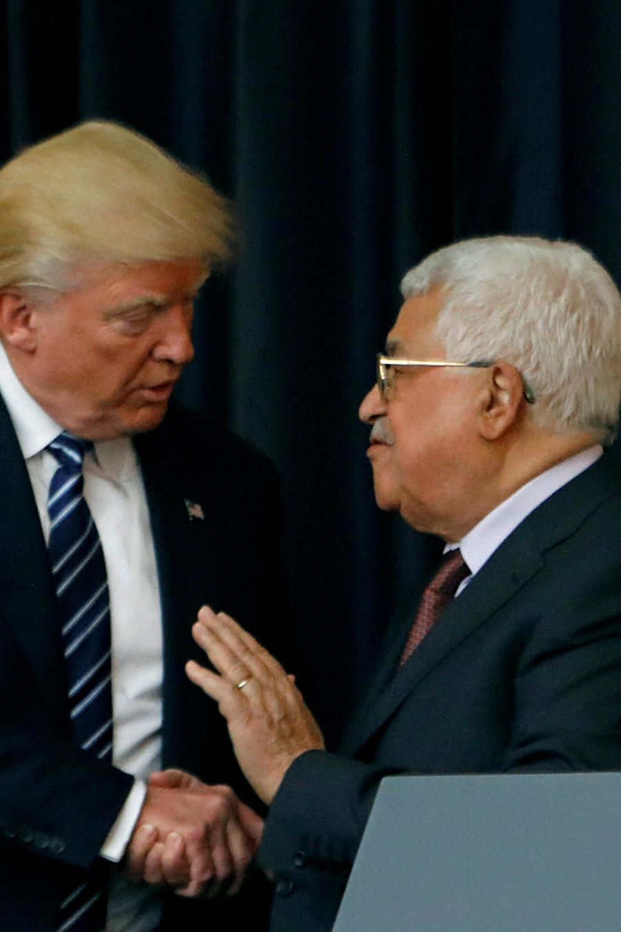 U.S. President Donald Trump shakes hands with Palestinian President Mahmoud Abbas during a joint news conference at the presidential headquarters in the West Bank town of Bethlehem