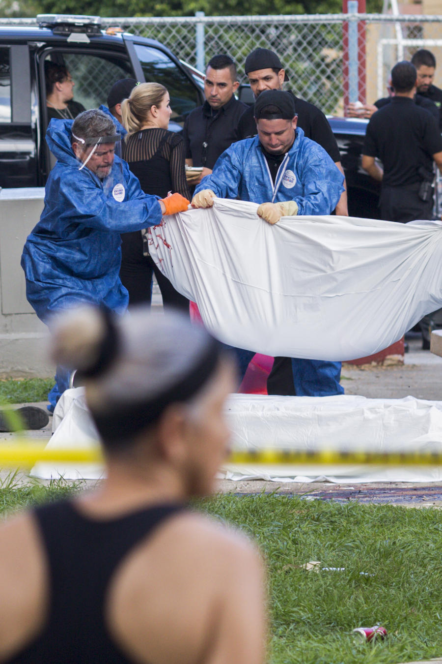 Police investigators recover the bodies at the the scene of a multiple killing in San Juan, Puerto Rico