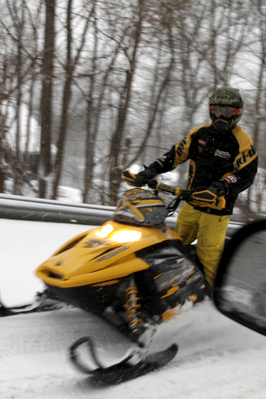 A man rides a snowmobile on a street in the village of Upper Nyack, New York, a northern suburb of New York City
