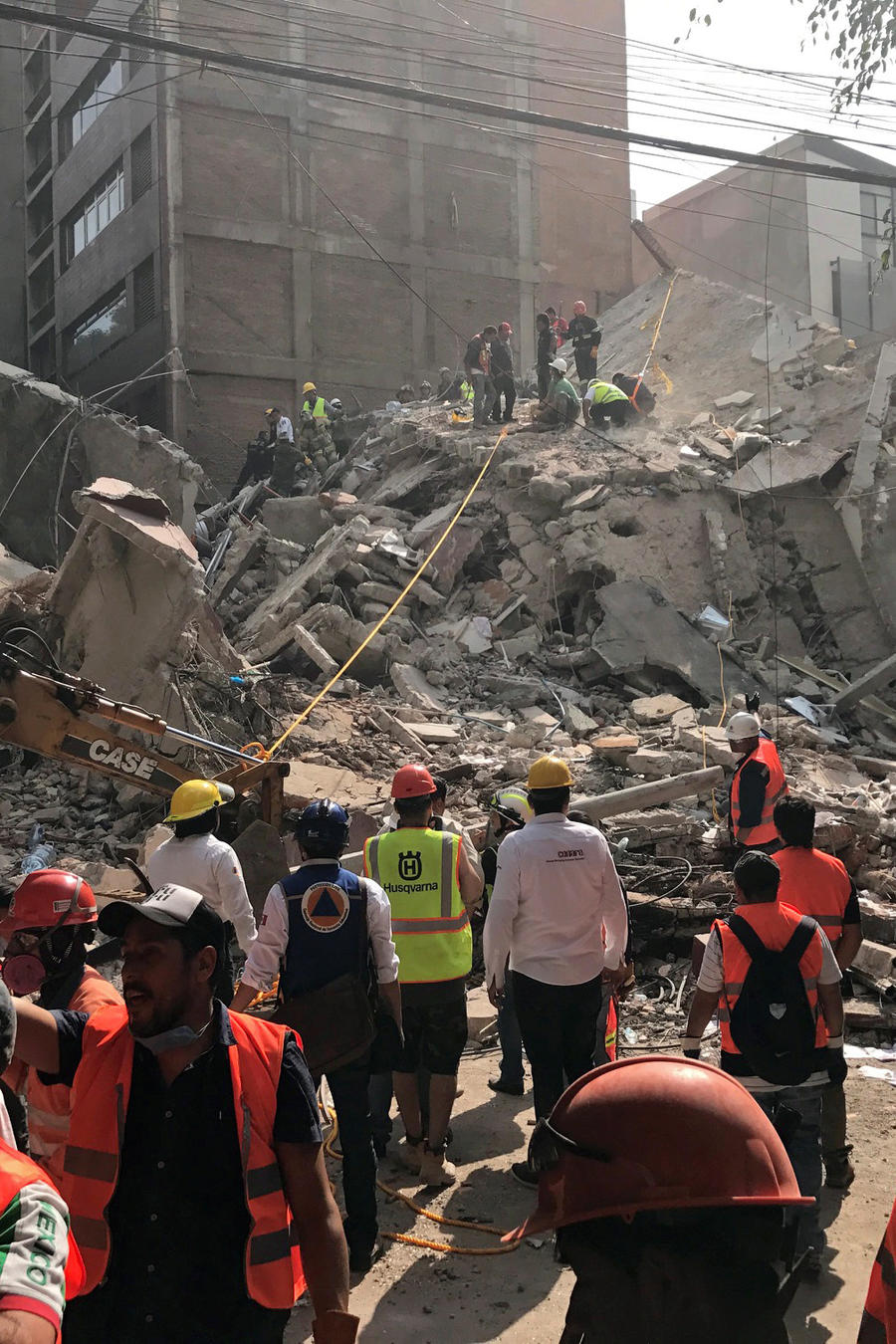People clear rubble after an earthquake hit Mexico City, Mexico