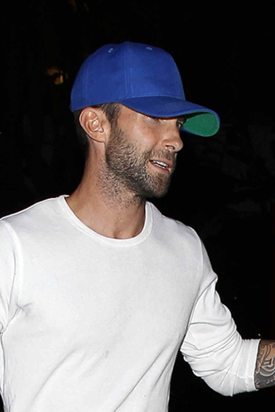 Adam Levine and Behati Prinsloo hold hands after the Lakers game **NO Australia, New Zealand**