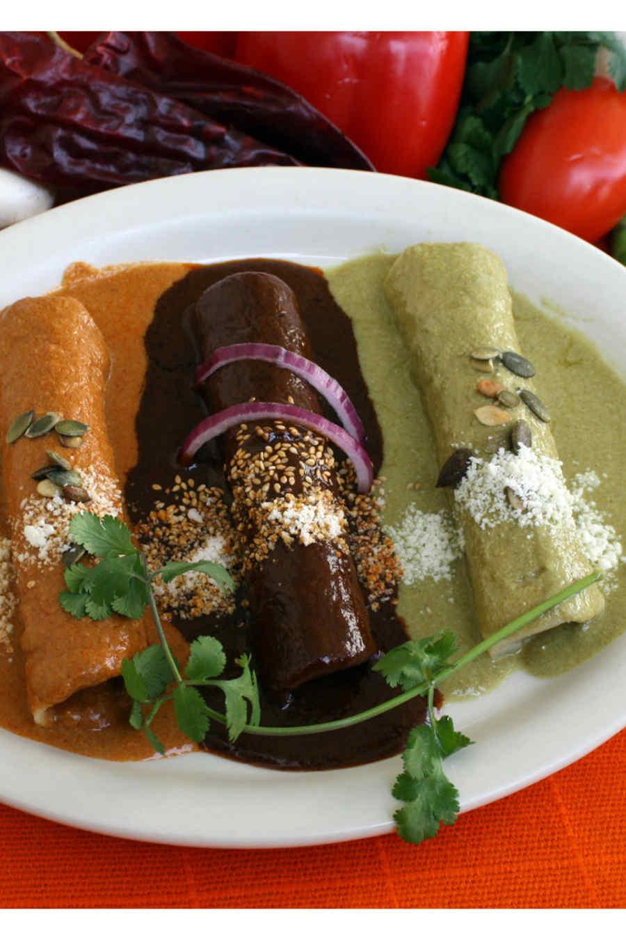 Three moles enchiladas smothered in mole poblano