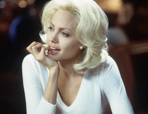 "Angelina Jolie is Lanie Kerrigan in "" Life or Something Like It"",  a television reporter. Picture courtesy of http://www.imdb.com"