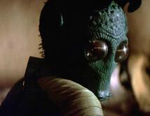 Soplón sin oficio, murió a manos de Han Solo en un bar de Mos Eisley.