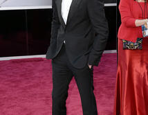 Eddie Redmayne en la alfombra roja de los Oscar