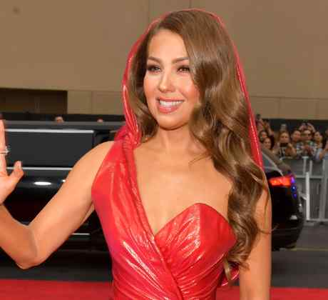 Thalia wearing a red-hooded dress at red carpet