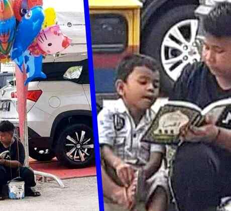 Enseña a su hermanito a leer en las calles de Indonesia