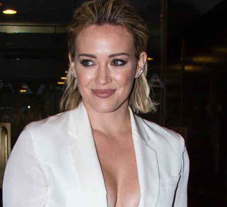 Hilary Duff shows off her decolletage in a crisp white pantsuit for her appearance on the 'Today' show in NYC