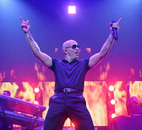 Pitbull singing at the iHeartRadio Fiesta Latina 2014