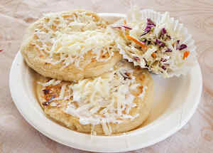 Pupusas on white plate with cole slaw